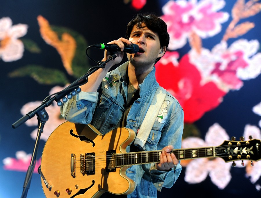 LOS ANGELES, CA - DECEMBER 07:  Musician Ezra Koenig of Vampire Weekend performs onstage during The 24th Annual KROQ Almost Acoustic Christmas at The Shrine Auditorium on December 7, 2013 in Los Angeles, California.  (Photo by Kevin Winter/Getty Images for CBS Radio)