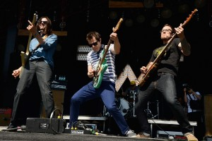 DOVER, DE - JUNE 22:  (L-R) Brian Bell, Rivers Cuomo and Scott Shriner of Weezer perform onstage during day 4 of the Firefly Music Festival on June 22, 2014 in Dover, Delaware.  (Photo by Theo Wargo/Getty Images for Firefly Music Festival)